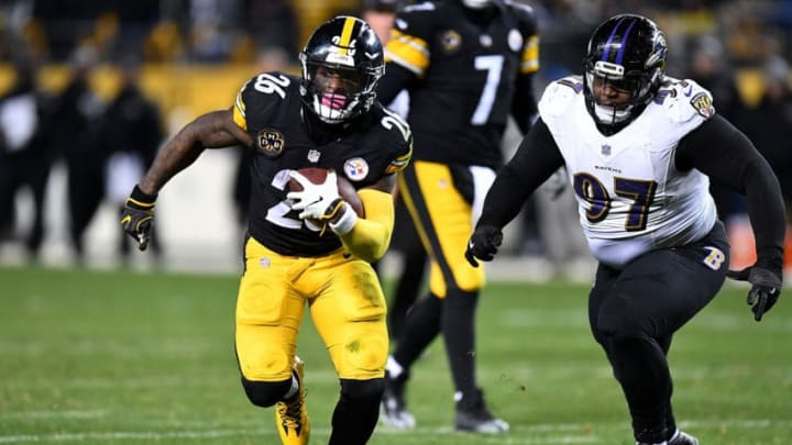 PITTSBURGH, PA - DECEMBER 10: Le'Veon Bell #26 of the Pittsburgh Steelers carries the ball against Michael Pierce #97 of the Baltimore Ravens in the second half during the game at Heinz Field on December 10, 2017 in Pittsburgh, Pennsylvania. (Photo by Joe Sargent/Getty Images)