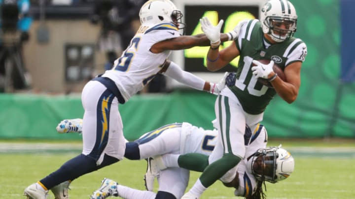 EAST RUTHERFORD, NJ - DECEMBER 24: Jermaine Kearse #10 of the New York Jets attempts to avoid the tackle attempt of Casey Hayward #26 of the Los Angeles Chargers in an NFL game at MetLife Stadium on December 24, 2017 in East Rutherford, New Jersey. (Photo by Ed Mulholland/Getty Images)