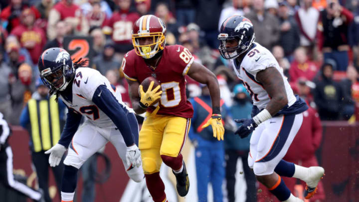 LANDOVER, MD - DECEMBER 24: Wide receiver Jamison Crowder #80 of the Washington Redskins rushes for a touchdown in front of free safety Bradley Roby #29 and inside linebacker Todd Davis #51 of the Denver Broncos after catching a second quarter pass at FedExField on December 24, 2017 in Landover, Maryland. (Photo by Rob Carr/Getty Images)