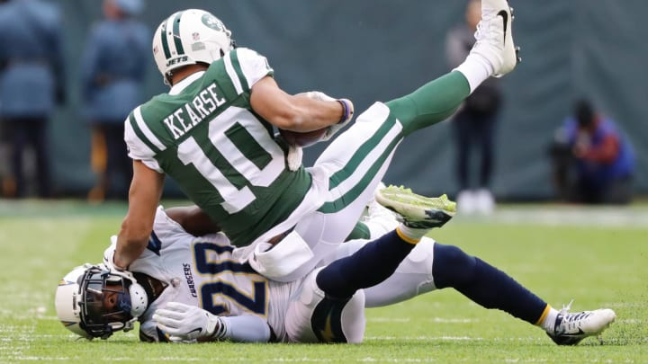 EAST RUTHERFORD, NJ – DECEMBER 24: Jermaine Kearse #10 of the New York Jets is tackled by Desmond King #20 of the Los Angeles Chargers during the first half of an NFL game at MetLife Stadium on December 24, 2017 in East Rutherford, New Jersey. (Photo by Abbie Parr/Getty Images)