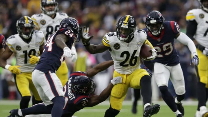 HOUSTON, TX - DECEMBER 25: Le'Veon Bell #26 of the Pittsburgh Steelers gives a stiff arm to Johnathan Joseph #24 of the Houston Texans in the first quarter at NRG Stadium on December 25, 2017 in Houston, Texas. (Photo by Tim Warner/Getty Images)
