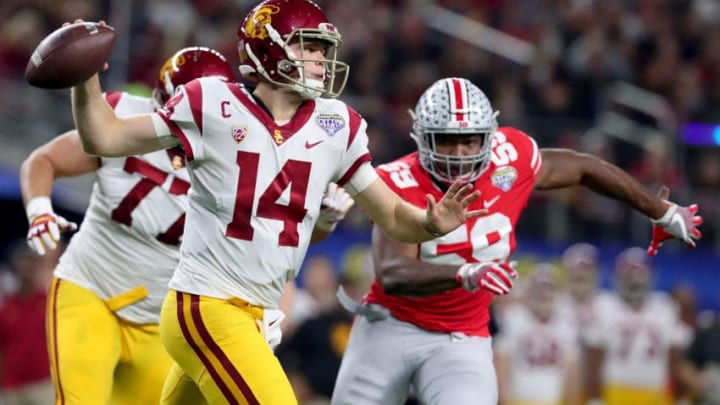 ARLINGTON, TX - DECEMBER 29: Sam Darnold #14 of the USC Trojans looks for an open receiver against Tyquan Lewis #59 of the Ohio State Buckeyes during the Goodyear Cotton Bowl Classic at AT&T Stadium on December 29, 2017 in Arlington, Texas. (Photo by Tom Pennington/Getty Images)