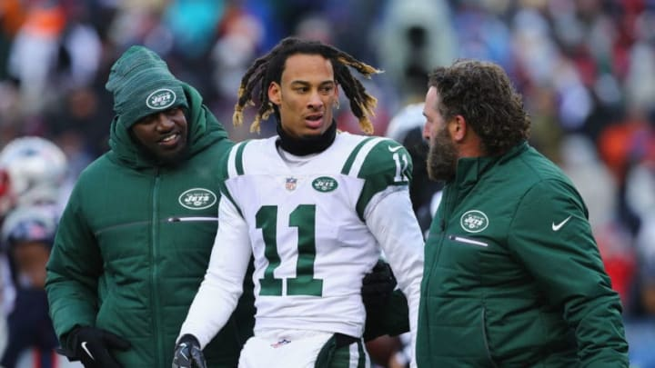 FOXBORO, MA - DECEMBER 31: Robby Anderson #11 of the New York Jets is helped off the field after suffering an injury during the second half against the New England Patriots at Gillette Stadium on December 31, 2017 in Foxboro, Massachusetts. (Photo by Maddie Meyer/Getty Images)