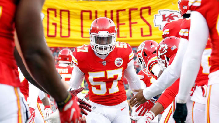 KANSAS CITY, MO - JANUARY 06: Linebacker Kevin Pierre-Louis #57 of the Kansas City Chiefs is greeted by teammates during player introductions prior to the AFC Wild Card Playoff game against the Tennessee Titans at Arrowhead Stadium on January 6, 2018 in Kansas City, Missouri. (Photo by Jamie Squire/Getty Images)