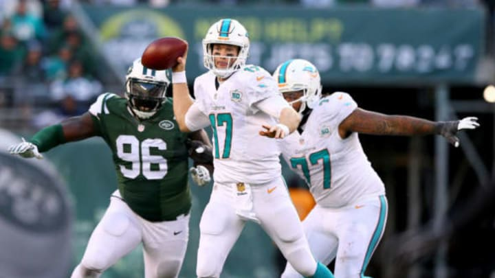EAST RUTHERFORD, NJ – NOVEMBER 29: Ryan Tannehill #17 of the Miami Dolphins scrambles as Muhammad Wilkerson #96 of the New York Jets defends on November 29, 2015 at MetLife Stadium in East Rutherford, New Jersey. (Photo by Elsa/Getty Images)