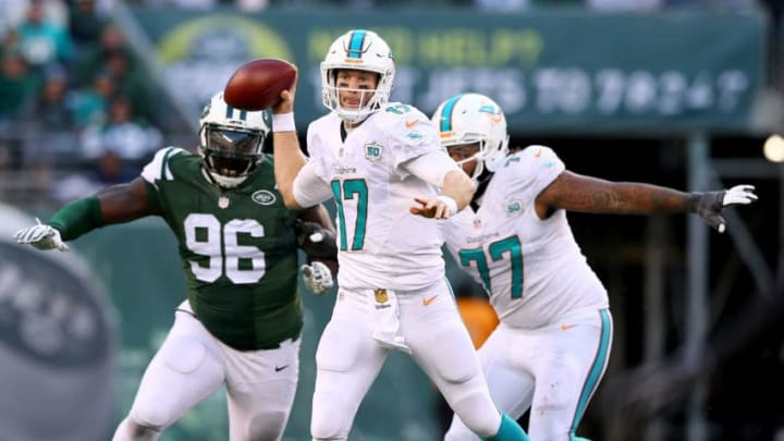 EAST RUTHERFORD, NJ - NOVEMBER 29: Ryan Tannehill #17 of the Miami Dolphins scrambles as Muhammad Wilkerson #96 of the New York Jets defends on November 29, 2015 at MetLife Stadium in East Rutherford, New Jersey. (Photo by Elsa/Getty Images)