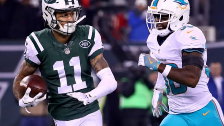 EAST RUTHERFORD, NJ – DECEMBER 17: Robby Anderson #11 of the New York Jets runs a 40 yard touchdown pass against Bacarri Rambo #30 of the Miami Dolphins during the first quarter of the game at MetLife Stadium on December 17, 2016 in East Rutherford, New Jersey. (Photo by Al Bello/Getty Images)