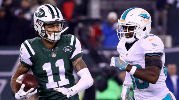EAST RUTHERFORD, NJ - DECEMBER 17: Robby Anderson #11 of the New York Jets runs a 40 yard touchdown pass against Bacarri Rambo #30 of the Miami Dolphins during the first quarter of the game at MetLife Stadium on December 17, 2016 in East Rutherford, New Jersey. (Photo by Al Bello/Getty Images)