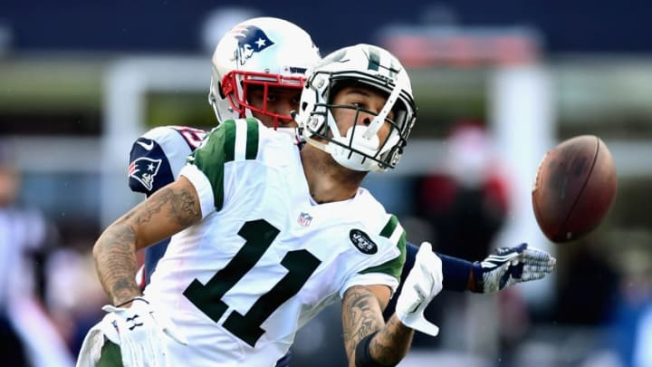 FOXBORO, MA - DECEMBER 24: Robby Anderson #11 of the New York Jets drops a pass during the second half of a game against the New England Patriots at Gillette Stadium on December 24, 2016 in Foxboro, Massachusetts. (Photo by Billie Weiss/Getty Images)