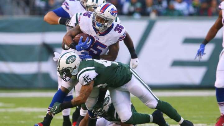 EAST RUTHERFORD, NJ - JANUARY 01: Rontez Miles #45 of the New York Jets tackles Mike Gillislee #35 of the Buffalo Bills during the second half at MetLife Stadium on January 1, 2017 in East Rutherford, New Jersey. (Photo by Ed Mulholland/Getty Images)