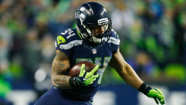 SEATTLE, WA – JANUARY 07: Thomas Rawls #34 of the Seattle Seahawks carries the ball during the second half against the Detroit Lions in the NFC Wild Card game at CenturyLink Field on January 7, 2017 in Seattle, Washington. (Photo by Jonathan Ferrey/Getty Images)