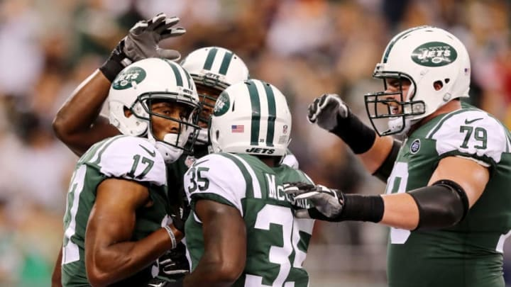 EAST RUTHERFORD, NJ - AUGUST 12: Charone Peake #17 of the New York Jets is congratulated by teammates Elijah McGuire #35 and Brent Qvale #79 after Peake scored a touchdown in the first quarter against the Tennessee Titans during a preseason game at MetLife Stadium on August 12, 2017 in East Rutherford, New Jersey. (Photo by Elsa/Getty Images)