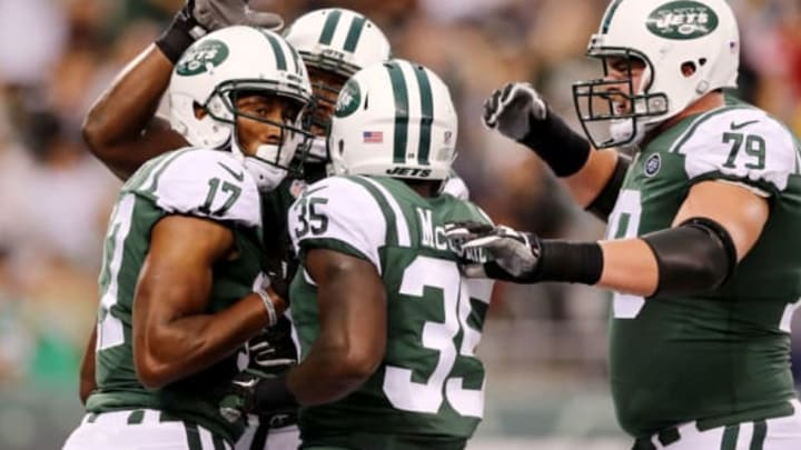 EAST RUTHERFORD, NJ – AUGUST 12: Charone Peake #17 of the New York Jets is congratulated by teammates Elijah McGuire #35 and Brent Qvale #79 after Peake scored a touchdown in the first quarter against the Tennessee Titans during a preseason game at MetLife Stadium on August 12, 2017 in East Rutherford, New Jersey. (Photo by Elsa/Getty Images)