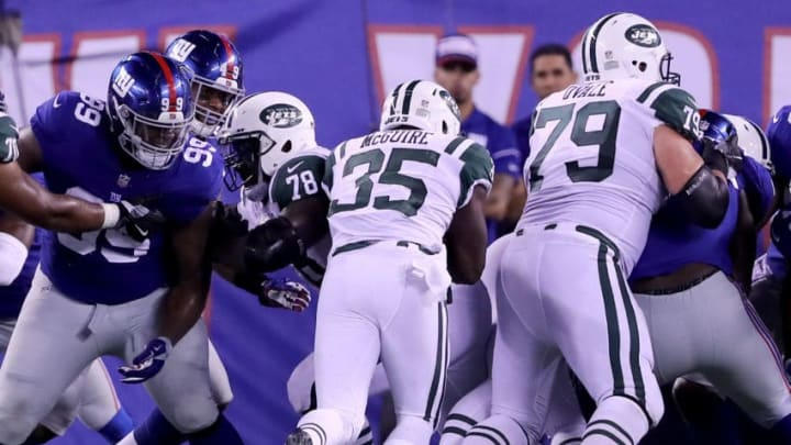 EAST RUTHERFORD, NJ - AUGUST 26: Elijah McGuire #35 of the New York Jets is unable to make the two point conversion as Robert Thomas #99 of the New York Giants defends in the fourth quarter during a preseason game on August 26, 2017 at MetLife Stadium in East Rutherford, New Jersey (Photo by Elsa/Getty Images)