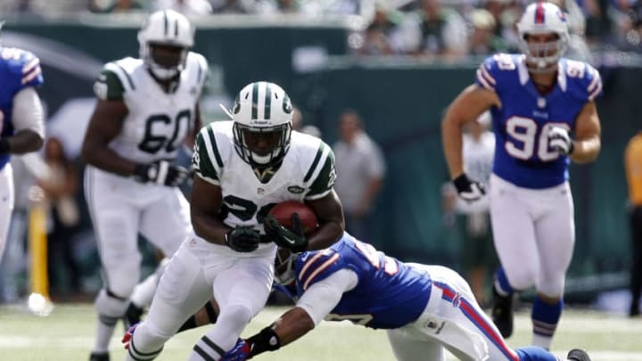 EAST RUTHERFORD, NJ - SEPTEMBER 09: Bilal Powell #29 of the New York Jets tries to break tackle of Nick Barnett #50 of the Buffalo Bills during their season opener at MetLife Stadium on September 9, 2012 in East Rutherford, New Jersey. (Photo by Jeff Zelevansky/Getty Images)