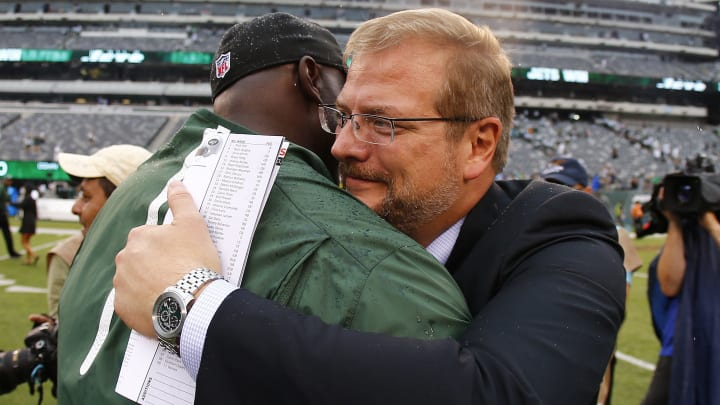 EAST RUTHERFORD, NJ – SEPTEMBER 13: Head coach Todd Bowles of the New York Jets is hugged by General Manager Mike Maccagnan after defeating the Cleveland Browns 31-10 for his first win as a head coach at MetLife Stadium on September 13, 2015 in East Rutherford, New Jersey. (Photo by Rich Schultz /Getty Images)