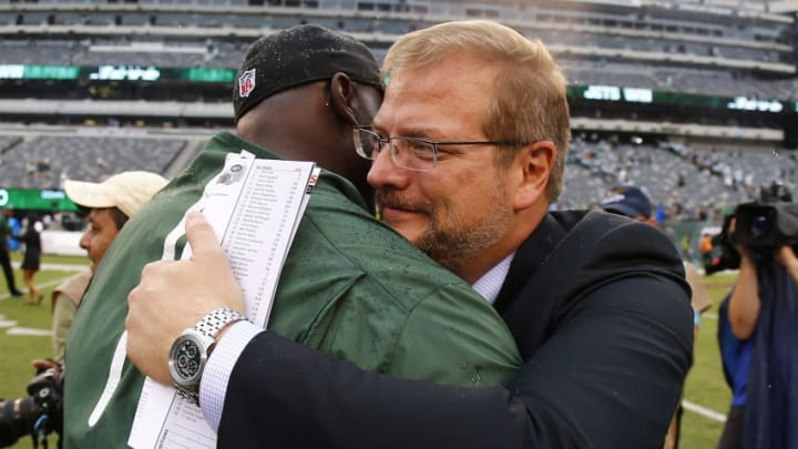 EAST RUTHERFORD, NJ - SEPTEMBER 13: Head coach Todd Bowles of the New York Jets is hugged by General Manager Mike Maccagnan after defeating the Cleveland Browns 31-10 for his first win as a head coach at MetLife Stadium on September 13, 2015 in East Rutherford, New Jersey. (Photo by Rich Schultz /Getty Images)