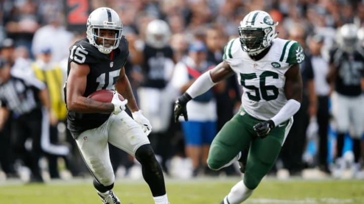 OAKLAND, CA - NOVEMBER 01: Michael Crabtree #15 of the Oakland Raiders runs for a 36-yard touchdown reception against the New York Jets during their NFL game at O.co Coliseum on November 1, 2015 in Oakland, California. (Photo by Ezra Shaw/Getty Images)