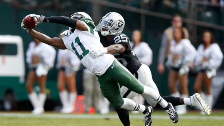 OAKLAND, CA - NOVEMBER 01: Jeremy Kerley #11 of the New York Jets makes a catch in front of D.J. Hayden #25 of the Oakland Raiders during their NFL game at O.co Coliseum on November 1, 2015 in Oakland, California. (Photo by Ezra Shaw/Getty Images)