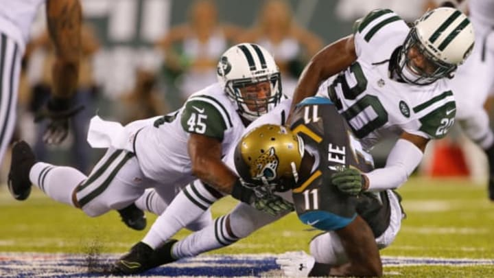 EAST RUTHERFORD, NJ – AUGUST 11: Marqise Lee #11 of the Jacksonville Jaguars is tackled by Rontez Miles #45 and Marcus Williams #20 of the New York Jets in an NFL preseason game at MetLife Stadium on August 11, 2016 in East Rutherford, New Jersey. (Photo by Rich Schultz/Getty Images)