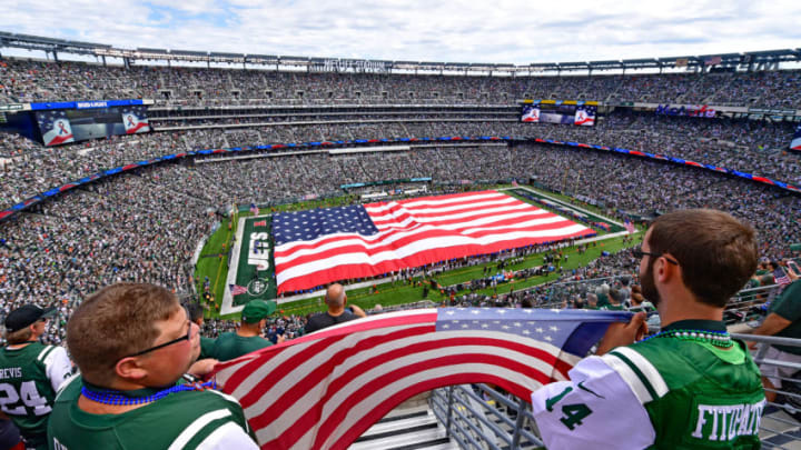 EAST RUTHERFORD, NJ - SEPTEMBER 11: Fans hold an American flag during the National Anthem prior to the game between the New York Jets and the Cincinnati Bengals at MetLife Stadium on September 11, 2016 in East Rutherford, New Jersey. (Photo by Steven Ryan/Getty Images)