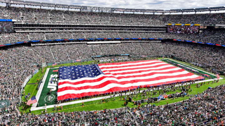 EAST RUTHERFORD, NJ - SEPTEMBER 11: The American flag is spead across the field during the National Anthem prior to the game between the New York Jets and the Cincinnati Bengals at MetLife Stadium on September 11, 2016 in East Rutherford, New Jersey. The Cincinnati Bengals defeated the New York Jets 23-22. (Photo by Steven Ryan/Getty Images)