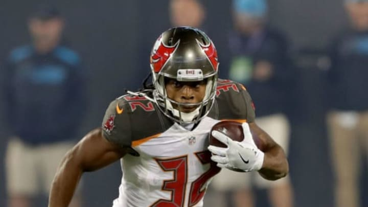 CHARLOTTE, NC – OCTOBER 10: Jacquizz Rodgers #32 of the Tampa Bay Buccaneers runs the ball against the Carolina Panthers in the 1st quarter during their game at Bank of America Stadium on October 10, 2016 in Charlotte, North Carolina. (Photo by Streeter Lecka/Getty Images)