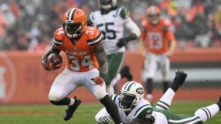 CLEVELAND, OH - OCTOBER 30: Isaiah Crowell #34 of the Cleveland Browns carries the ball in front of a diving Muhammad Wilkerson #96 of the New York Jets during the second quarter at FirstEnergy Stadium on October 30, 2016 in Cleveland, Ohio. (Photo by Jason Miller/Getty Images)