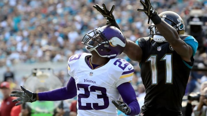 JACKSONVILLE, FL - DECEMBER 11: Marqise Lee #11 of the Jacksonville Jaguars catches a pass over Terence Newman #23 of the Minnesota Vikings during the game at EverBank Field on December 11, 2016 in Jacksonville, Florida. (Photo by Sam Greenwood/Getty Images)