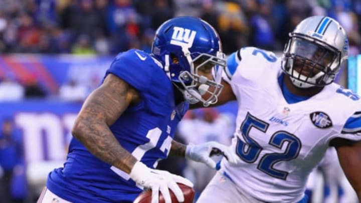 EAST RUTHERFORD, NJ – DECEMBER 18: Odell Beckham Jr. #13 of the New York Giants carries the ball against Antwione Williams #52 of the Detroit Lions in the second half at MetLife Stadium on December 18, 2016 in East Rutherford, New Jersey. The Giants won 17-6. (Photo by Al Bello/Getty Images)