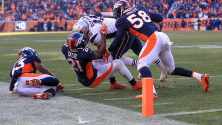 DENVER, CO – DECEMBER 18: Fullback James Develin #46 of the New England Patriots is stopped short of the goal line by outside linebacker Von Miller #58 of the Denver Broncos and cornerback Aqib Talib #21 of the Denver Broncos at Sports Authority Field at Mile High on December 18, 2016 in Denver, Colorado. (Photo by Sean M. Haffey/Getty Images)