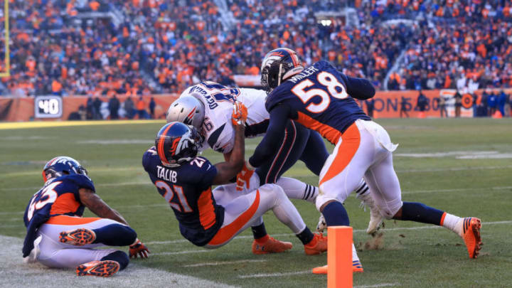 DENVER, CO - DECEMBER 18: Fullback James Develin #46 of the New England Patriots is stopped short of the goal line by outside linebacker Von Miller #58 of the Denver Broncos and cornerback Aqib Talib #21 of the Denver Broncos at Sports Authority Field at Mile High on December 18, 2016 in Denver, Colorado. (Photo by Sean M. Haffey/Getty Images)