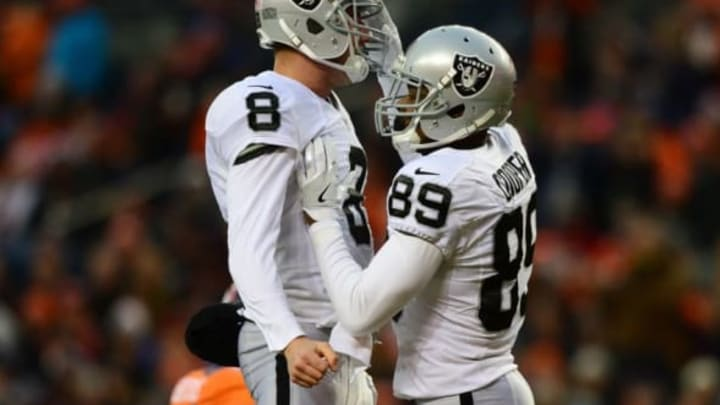 DENVER, CO – JANUARY 1: Wide receiver Amari Cooper #89 of the Oakland Raiders celebrates his touchdown with quarterback Connor Cook #8 in the third quarter of the game against the Denver Broncos at Sports Authority Field at Mile High on January 1, 2017 in Denver, Colorado. (Photo by Dustin Bradford/Getty Images)