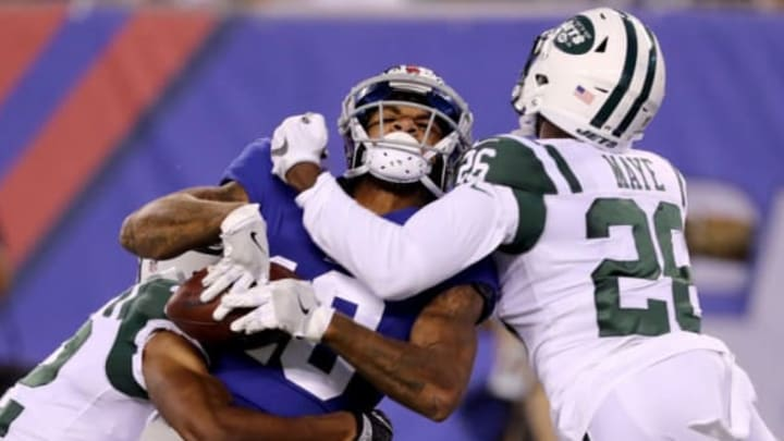 EAST RUTHERFORD, NJ – AUGUST 26: Roger Lewis Jr.#18 of the New York Giants is tackled by Juston Burris #32 and Marcus Maye #26 of the New York Jets during a preseason game on August 26, 2017 at MetLife Stadium in East Rutherford, New Jersey (Photo by Elsa/Getty Images)