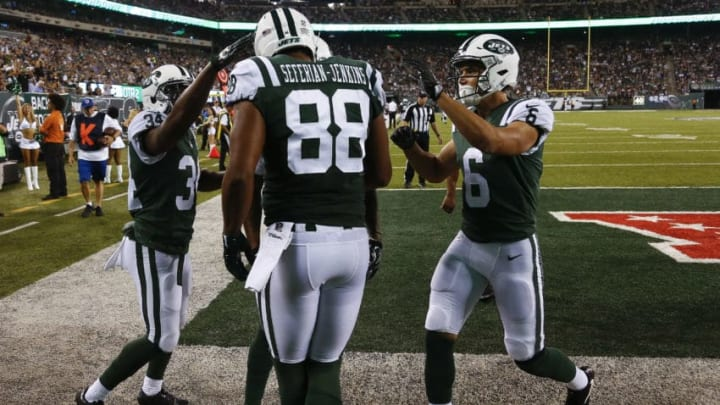 EAST RUTHERFORD, NJ - AUGUST 31: Austin Seferian-Jenkins #88 of the New York Jets celebrates his touchdown with teammates Jeremy Clark #34 and Chad Hansen #6 of the New York Jets during their preseason game against the Philadelphia Eagles at MetLife Stadium on August 31, 2017 in East Rutherford, New Jersey. (Photo by Jeff Zelevansky/Getty Images)