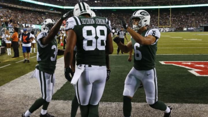 EAST RUTHERFORD, NJ – AUGUST 31: Austin Seferian-Jenkins #88 of the New York Jets celebrates his touchdown with teammates Jeremy Clark #34 and Chad Hansen #6 of the New York Jets during their preseason game against the Philadelphia Eagles at MetLife Stadium on August 31, 2017 in East Rutherford, New Jersey. (Photo by Jeff Zelevansky/Getty Images)