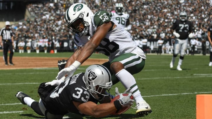 OAKLAND, CA - SEPTEMBER 17: DeAndre Washington #33 of the Oakland Raiders gets tackled at the one yard line by Darron Lee #58 of the New York Jets during the first quarter of their NFL football game at Oakland-Alameda County Coliseum on September 17, 2017 in Oakland, California. (Photo by Thearon W. Henderson/Getty Images)