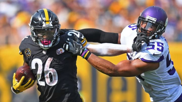 PITTSBURGH, PA - SEPTEMBER 17: Le'Veon Bell #26 of the Pittsburgh Steelers stiff arms Anthony Barr #55 of the Minnesota Vikings as he carries in the ball in the second half during the game at Heinz Field on September 17, 2017 in Pittsburgh, Pennsylvania. (Photo by Joe Sargent/Getty Images)