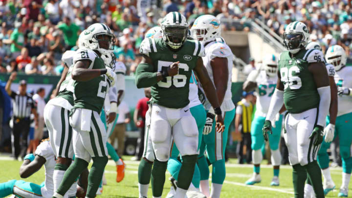 EAST RUTHERFORD, NJ - SEPTEMBER 24: Demario Davis #56 of the New York Jets celebrates a tackle against the Miami Dolphins during the first half of an NFL game at MetLife Stadium on September 24, 2017 in East Rutherford, New Jersey. (Photo by Al Bello/Getty Images)