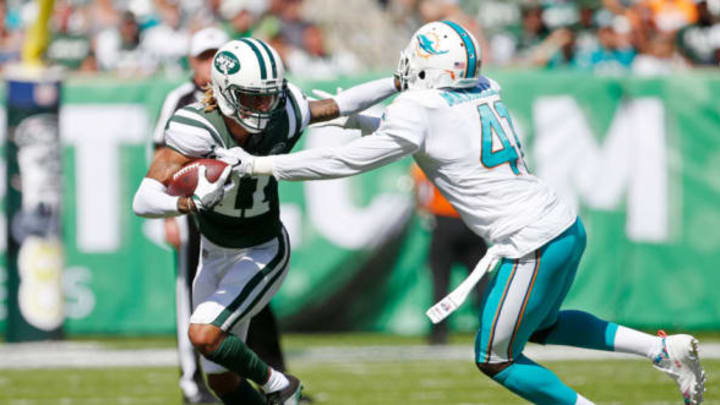 EAST RUTHERFORD, NJ – SEPTEMBER 24: Robby Anderson #11 of the New York Jets avoids the tackle attempt from Byron Maxwell #41 of the Miami Dolphins during the first half of an NFL game at MetLife Stadium on September 24, 2017 in East Rutherford, New Jersey. (Photo by Rich Schultz/Getty Images)