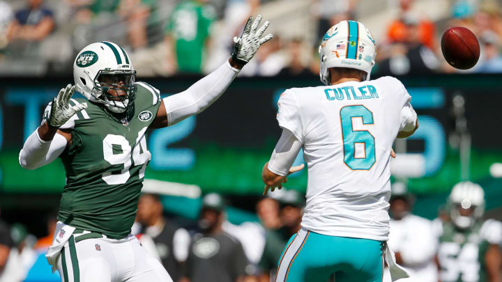 EAST RUTHERFORD, NJ – SEPTEMBER 24: Jay Cutler #6 of the Miami Dolphins has his pass attempt defended by Kony Ealy #94 of the New York Jets during the first half of an NFL game at MetLife Stadium on September 24, 2017 in East Rutherford, New Jersey. (Photo by Rich Schultz/Getty Images)