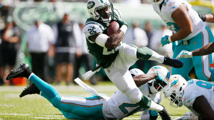 EAST RUTHERFORD, NJ - SEPTEMBER 24: Elijah McGuire #25 of the New York Jets is tripped up by Reshad Jones #20 of the Miami Dolphins during the first half of an NFL game at MetLife Stadium on September 24, 2017 in East Rutherford, New Jersey. (Photo by Rich Schultz/Getty Images)
