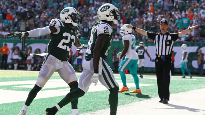 EAST RUTHERFORD, NJ - SEPTEMBER 24: Terrence Brooks #23 congratulates Morris Claiborne #21 of the New York Jets after breaking up a pass attempt on fourth down against the Miami Dolphins during the second half of an NFL game at MetLife Stadium on September 24, 2017 in East Rutherford, New Jersey. The New York Jets defeated the Miami Dolphins 20-6. (Photo by Al Bello/Getty Images)