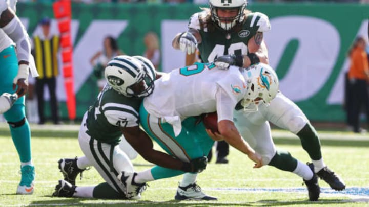EAST RUTHERFORD, NJ – SEPTEMBER 24: Jay Cutler #6 of the Miami Dolphins is sacked by David Bass #47 and Dylan Donahue #49 of the New York Jets during the second half of an NFL game at MetLife Stadium on September 24, 2017 in East Rutherford, New Jersey. The New York Jets defeated the Miami Dolphins 20-6. (Photo by Al Bello/Getty Images)