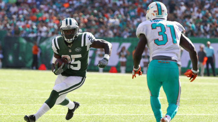 EAST RUTHERFORD, NJ - SEPTEMBER 24: Elijah McGuire #25 of the New York Jets runs against Michael Thomas #31 of the Miami Dolphins during the second half of an NFL game at MetLife Stadium on September 24, 2017 in East Rutherford, New Jersey. The New York Jets defeated the Miami Dolphins 20-6. (Photo by Al Bello/Getty Images)