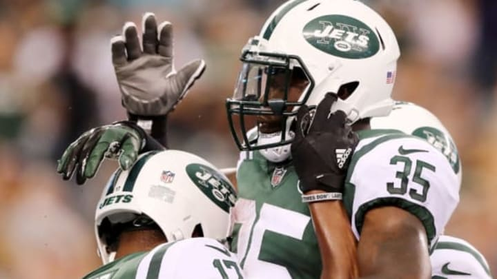 EAST RUTHERFORD, NJ – AUGUST 12: Charone Peake #17 of the New York Jets is congratulated by teammate Elijah McGuire #35 after Peake scored a touchdown in the first quarter against the Tennessee Titans during a preseason game at MetLife Stadium on August 12, 2017 in East Rutherford, New Jersey. (Photo by Elsa/Getty Images)
