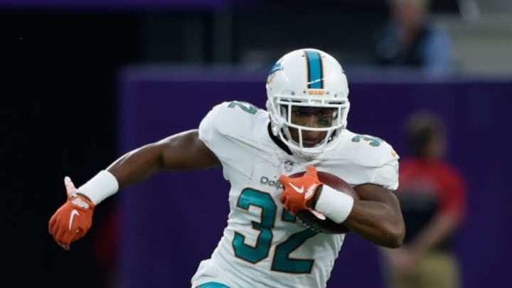 MINNEAPOLIS, MN – AUGUST 31: Kenyan Drake #32 of the Miami Dolphins carries the ball against the Minnesota Vikings during the first quarter in the preseason game on August 31, 2017 at U.S. Bank Stadium in Minneapolis, Minnesota. (Photo by Hannah Foslien/Getty Images)