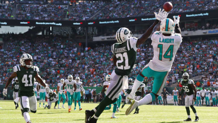 EAST RUTHERFORD, NJ - SEPTEMBER 24: Morris Claiborne #21 of the New York Jets break up a pass intended for Jarvis Landry #14 of the Miami Dolphins during the second half of an NFL game at MetLife Stadium on September 24, 2017 in East Rutherford, New Jersey. The New York Jets defeated the Miami Dolphins 20-6.(Photo by Al Bello/Getty Images)