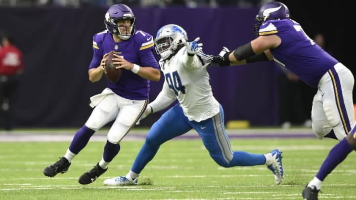MINNEAPOLIS, MN - OCTOBER 1: Case Keenum #7 of the Minnesota Vikings drops back to pass the ball while pursued by defender Ezekiel Ansah #94 of the Detroit Lions in the second half of the game on October 1, 2017 at U.S. Bank Stadium in Minneapolis, Minnesota. (Photo by Hannah Foslien/Getty Images)