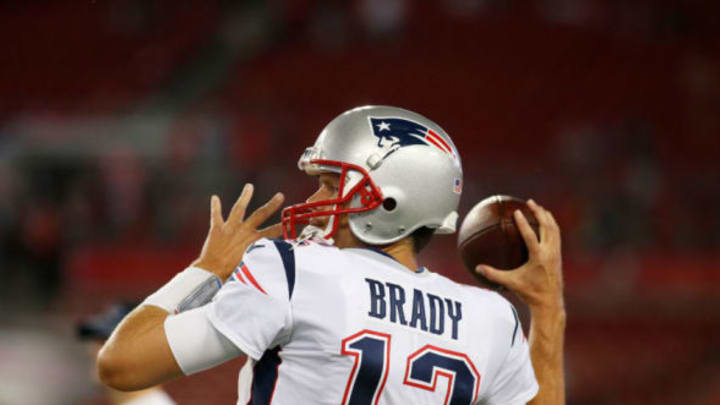 TAMPA, FL – OCTOBER 5: Quarterback Tom Brady #12 of the New England Patriots warms up on the field before the start of an NFL football game against the Tampa Bay Buccaneers on October 5, 2017 at Raymond James Stadium in Tampa, Florida. (Photo by Brian Blanco/Getty Images)